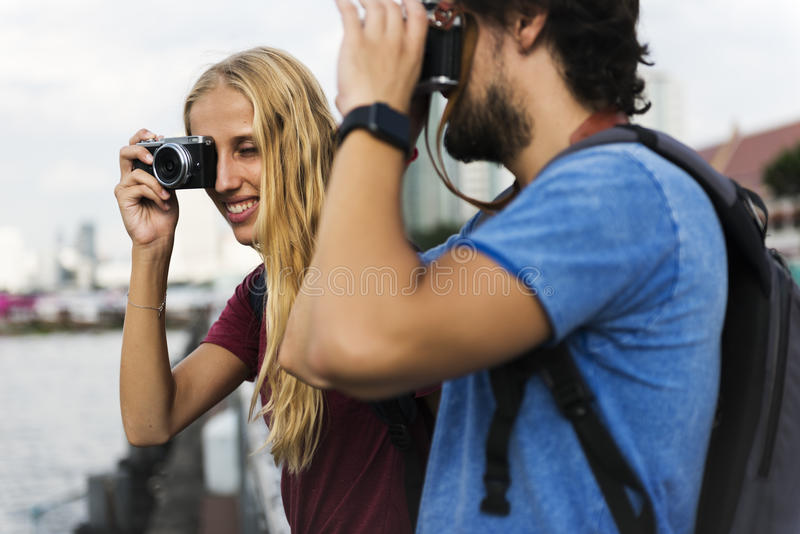 Couple traveling together with a camera royalty free stock photography
