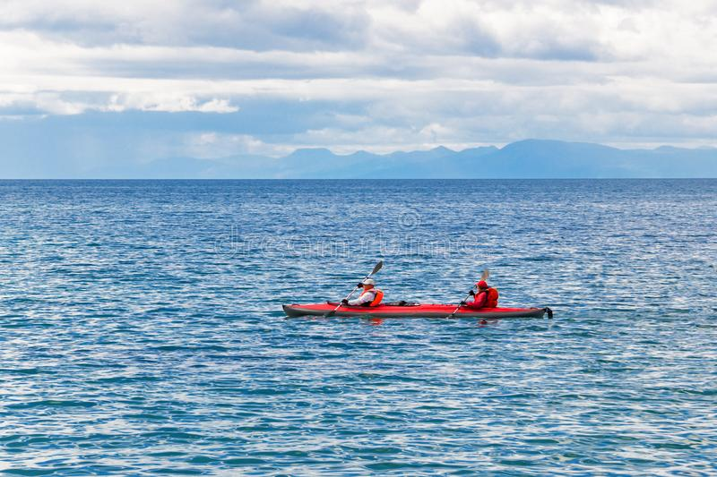 A couple travels by canoe stock photo