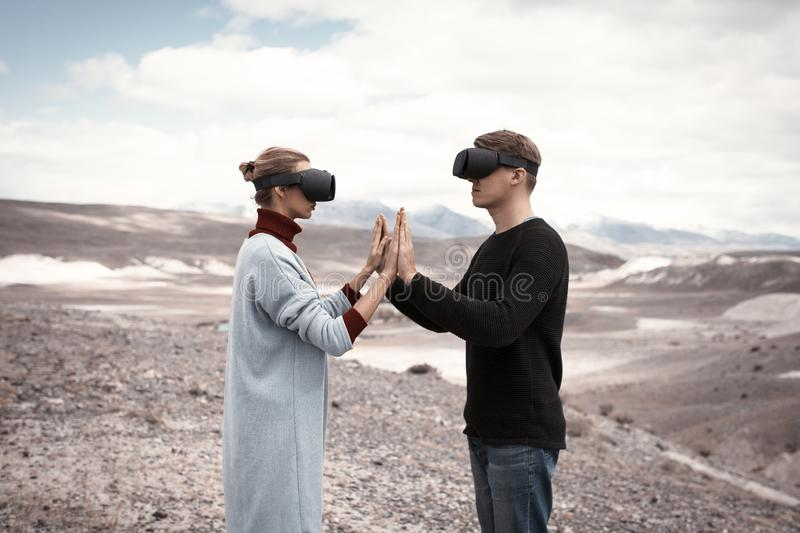 Couple travels in virtual reality royalty free stock photos