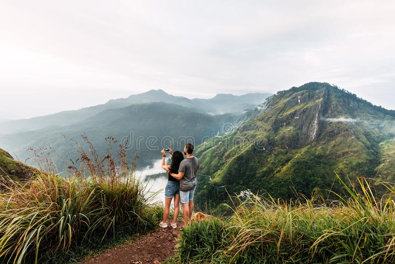 The couple travels the world. A couple in love travels to Sri Lanka. The couple travels to Asia. Man and woman meet the dawn in royalty free stock photo