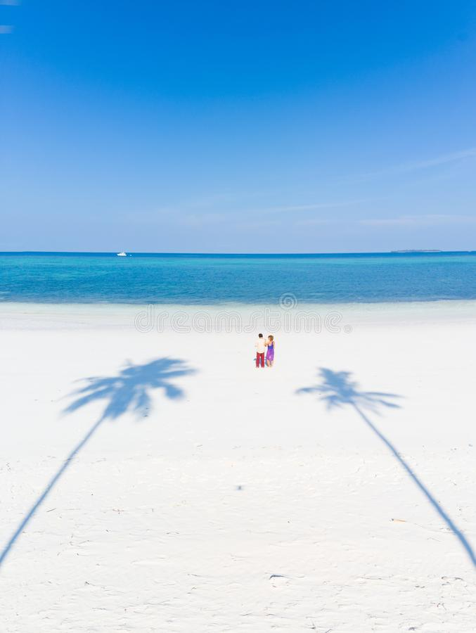 Couple on tropical beach at Pasir Panjang, Kei Islands, tropical archipelago Indonesia, Moluccas, coral reef white sand beach royalty free stock images