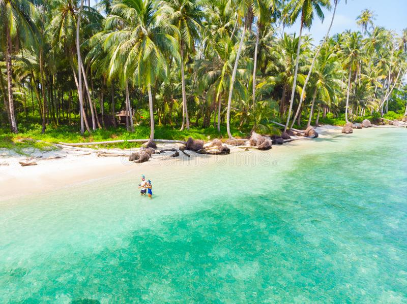 Couple on tropical beach at Tailana Banyak Islands Sumatra tropical archipelago Indonesia, Aceh, coral reef white sand beach royalty free stock photo