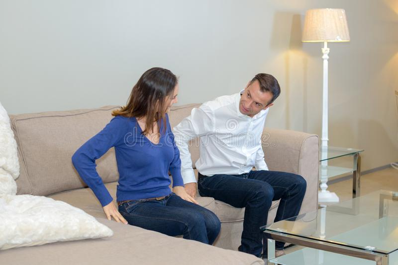 Couple trying couch royalty free stock images