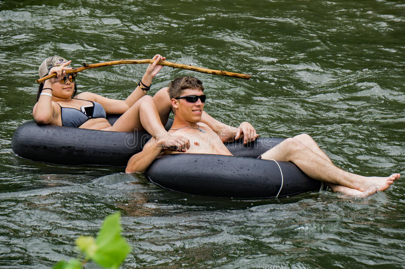 Couple Tubing on the Roanoke River royalty free stock images