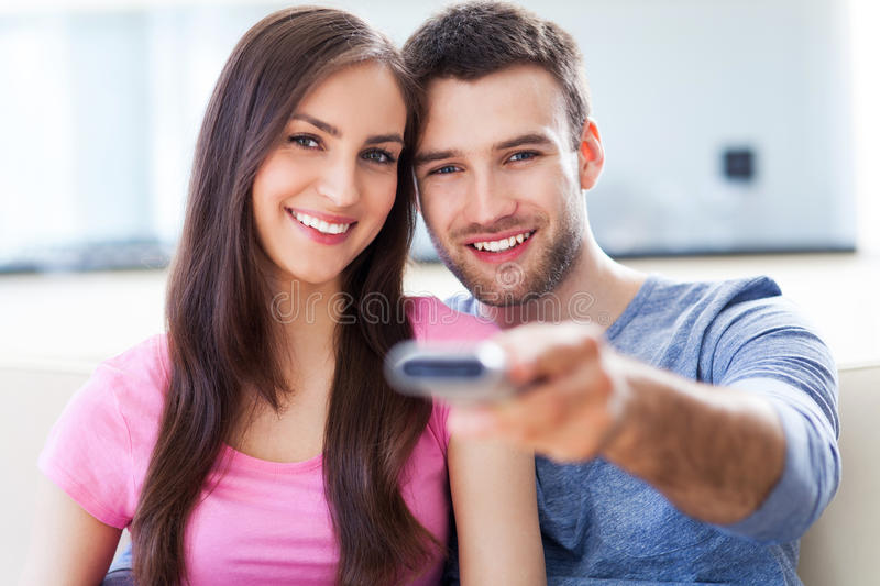 Couple With TV Remote Stock Images