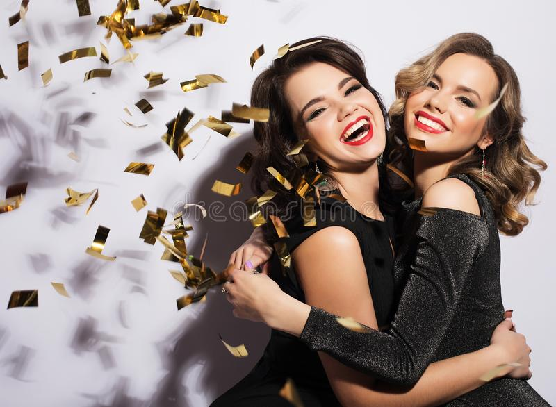 Couple of Two Rich Women Laughing with Crystal of Champagne. Luxury. Party time. Couple of Two Young Rich Women Laughing with Crystal of Champagne. Luxury royalty free stock photography