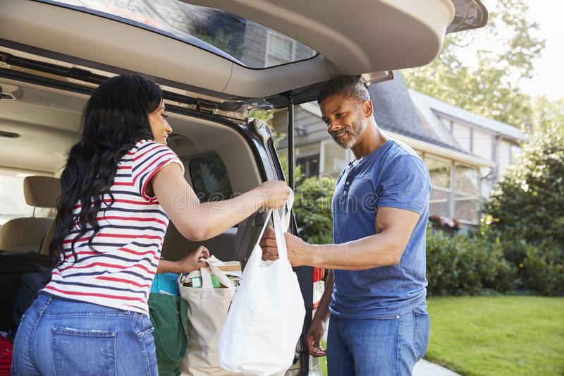 Couple Unloading Shopping Bags From Car royalty free stock photo