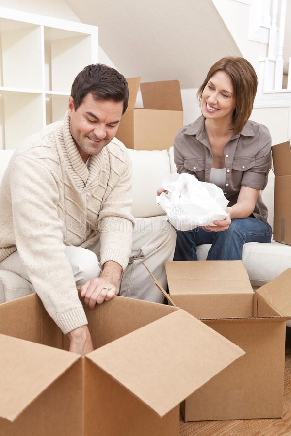 Couple Unpacking or Packing Boxes Moving House royalty free stock images