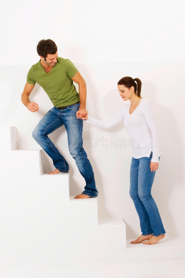Couple up the stairs holding hands royalty free stock images