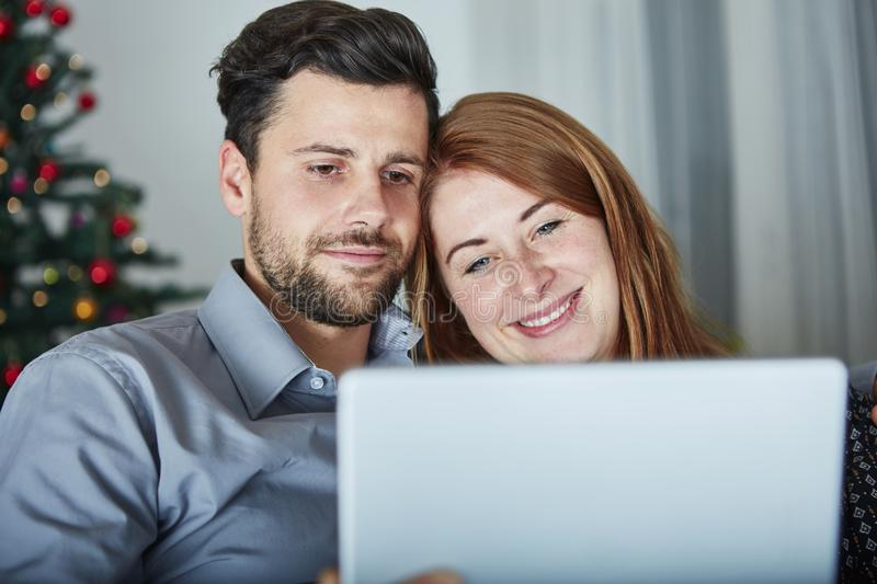Couple use or watch something on tablet pc stock images