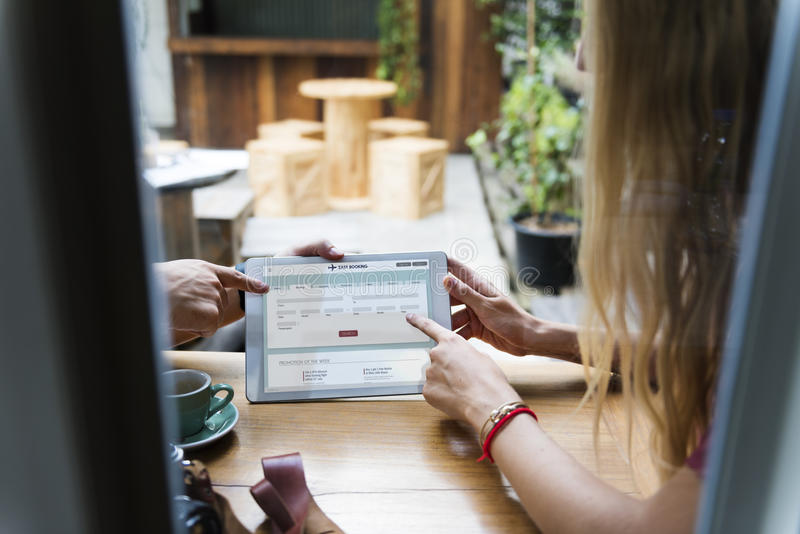 Couple using digital tablet in a cafe Concept royalty free stock images