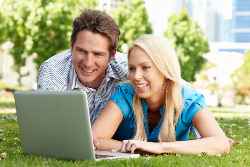 Download Couple Using Laptop In City Park Stock Photo - Image: 20892686
