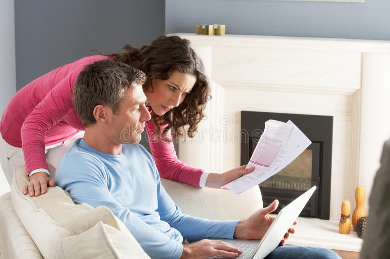 Download Couple Using Laptop And Discussing Bills Stock Photo - Image: 14727848