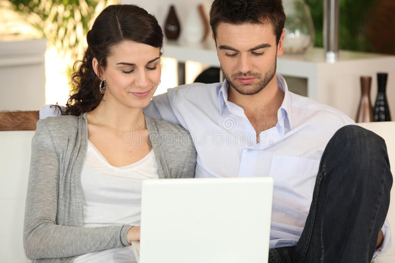 Download Couple Using Laptop At Home Royalty Free Stock Image - Image: 25755576
