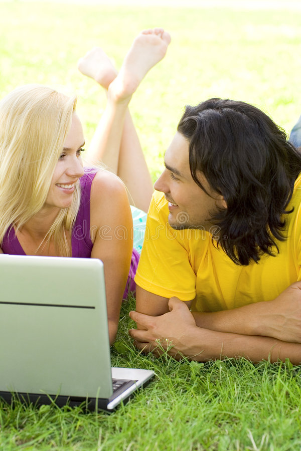 Download Couple Using Laptop Outdoors Stock Image - Image: 5939779