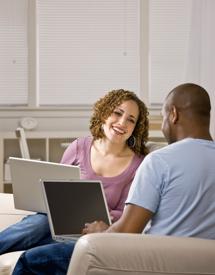 Download Couple Using Laptops In Livingroom Stock Image - Image: 6602345