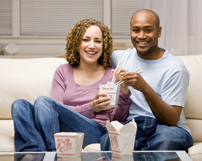 Couple using sharing chinese take-out royalty free stock images