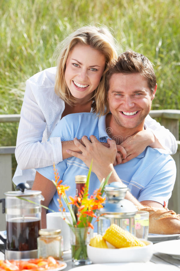 Couple on vacation eating outdoors stock images