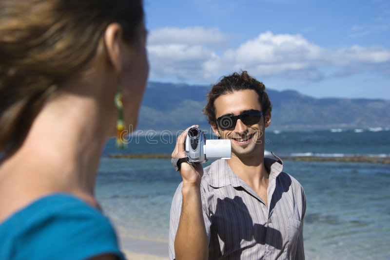 Couple with video camera. stock images