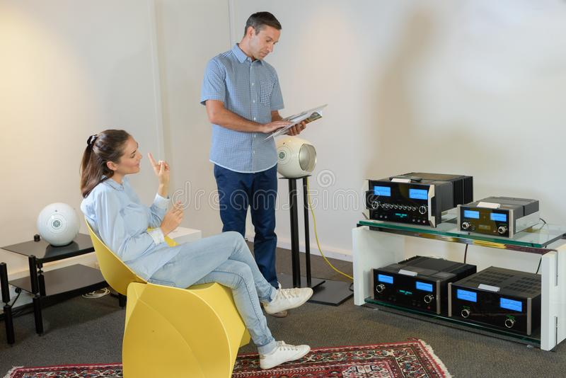 Couple viewing musical technology royalty free stock photography