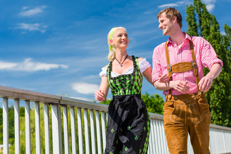 Couple visiting Bavarian fair having fun stock photography