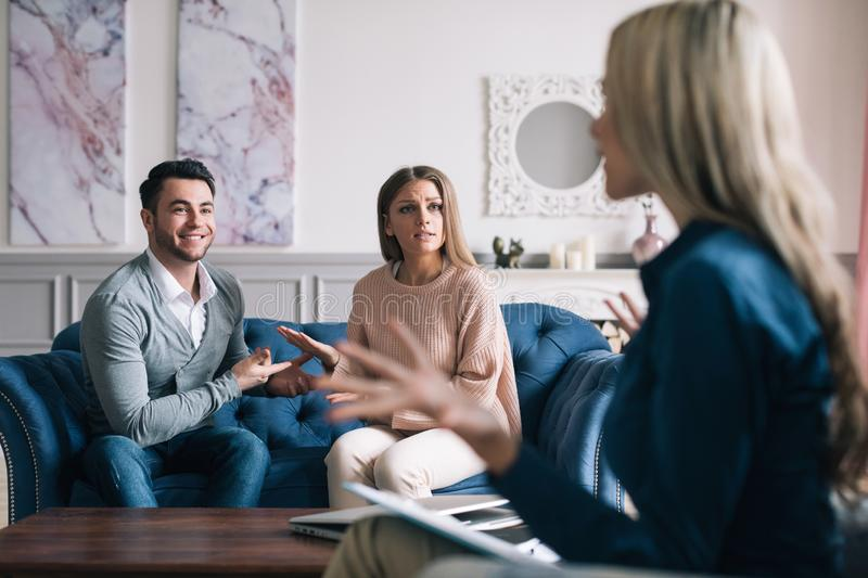 Couple visiting psychologist. stock images