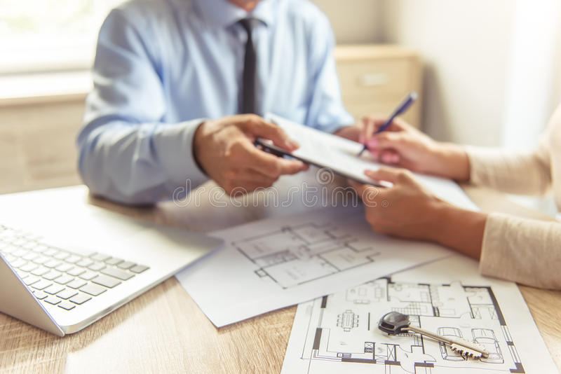 Download Couple visiting realtor stock photo. Image of document - 77575110