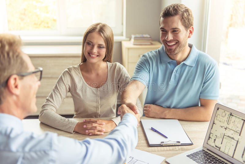 Download Couple visiting realtor stock image. Image of adult, coffee - 77575419