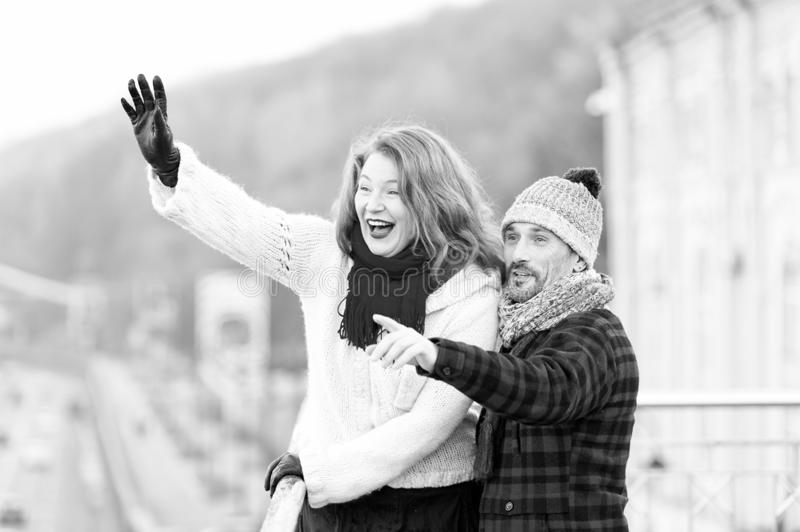 Couple wag to air. Atractive woman wag from bridge. Happy lady with guy welcomes to friends. Couple wag to air. Red hair women wag from the bridge. Happy lady royalty free stock photo