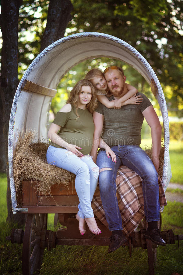 The couple in the wagon royalty free stock image