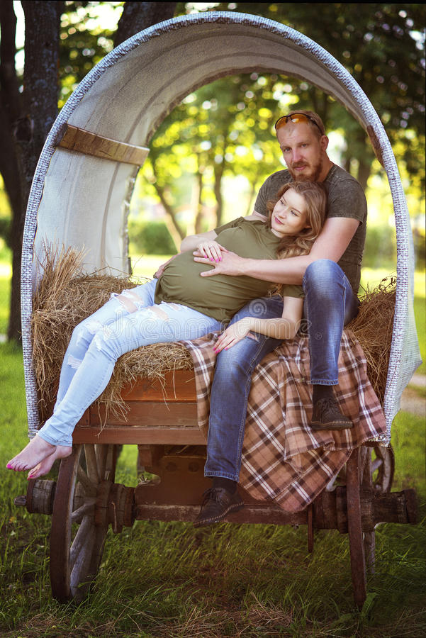 The couple in the wagon royalty free stock photo