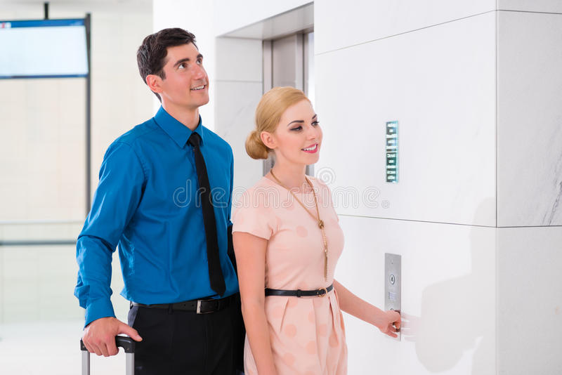Couple waiting for hotel elevator royalty free stock images