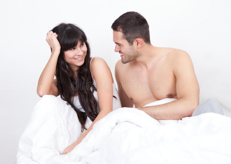 Couple Waking Up In Bed Royalty Free Stock Photo