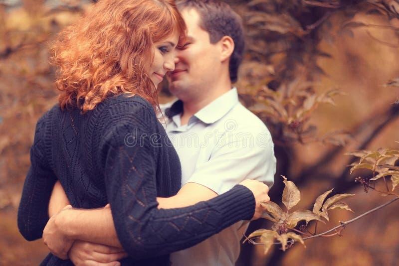Couple walk in autumn park royalty free stock photos