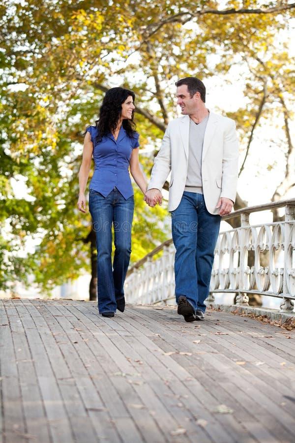 Couple Walk Bridge royalty free stock photo