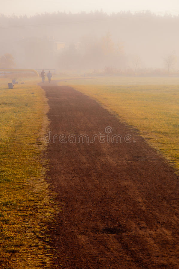 Download Couple walk in the mist stock image. Image of lane, outdoor - 22176385