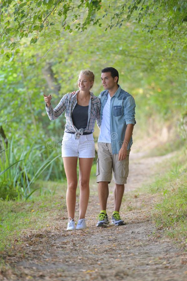 Couple walking along country path. Couple royalty free stock images