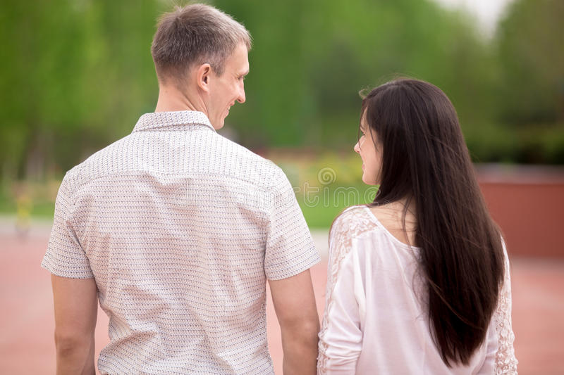 Couple walking, back view stock images