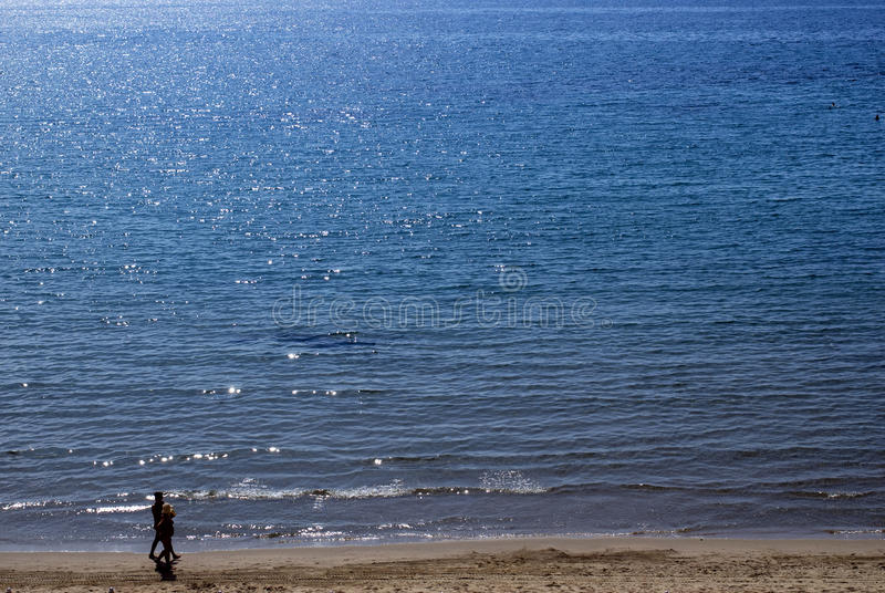 Download Couple Walking On The Beach Stock Photo - Image: 9541700