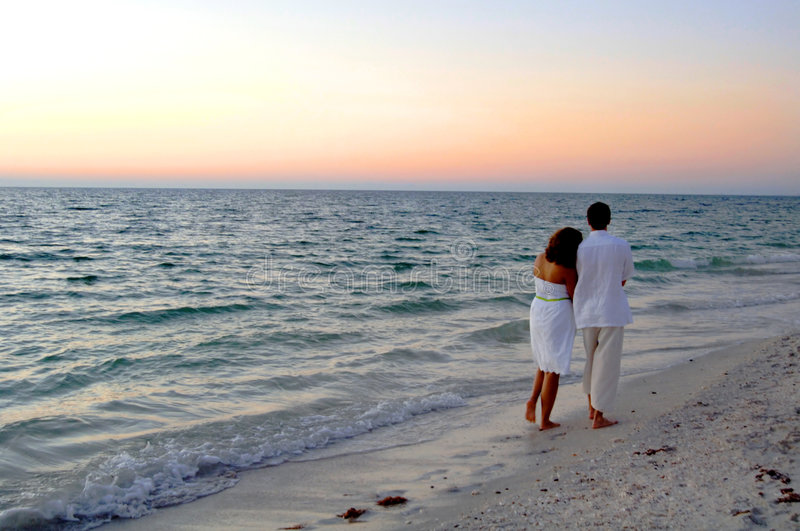 Download Couple Walking On Beach At Sunset Stock Image - Image: 7396801