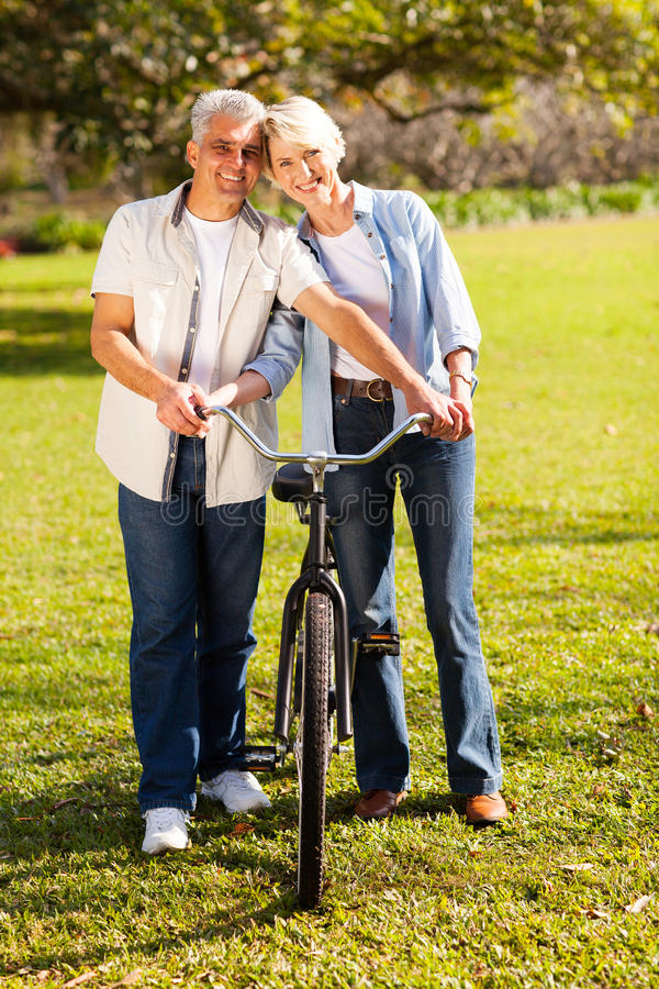 Couple walking bike stock photo