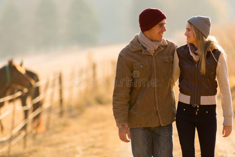 Couple walking countryside stock photo
