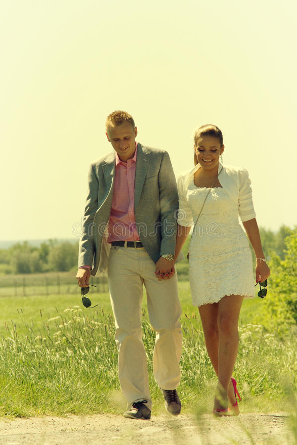 Couple walking in field stock images