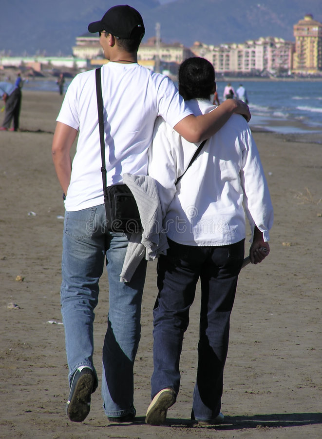 Download Couple Walking - He And His Mother Editorial Image - Image of waves, wind: 104855
