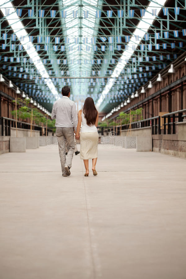 Couple Walking Holding Hands stock photos