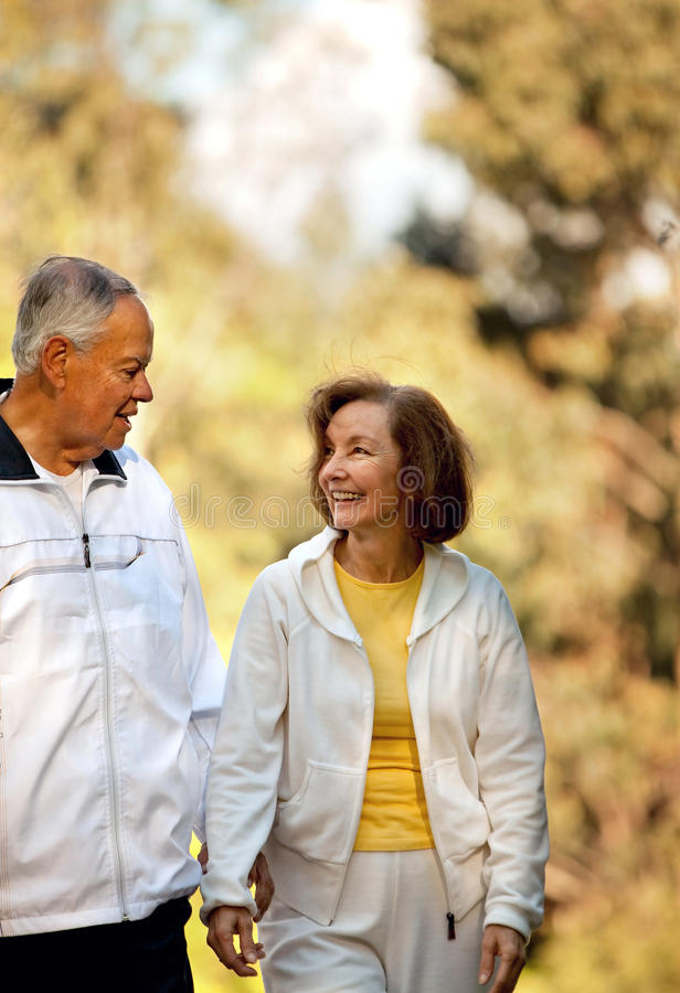 Download Couple walking outdoors stock image. Image of retirement - 14756499