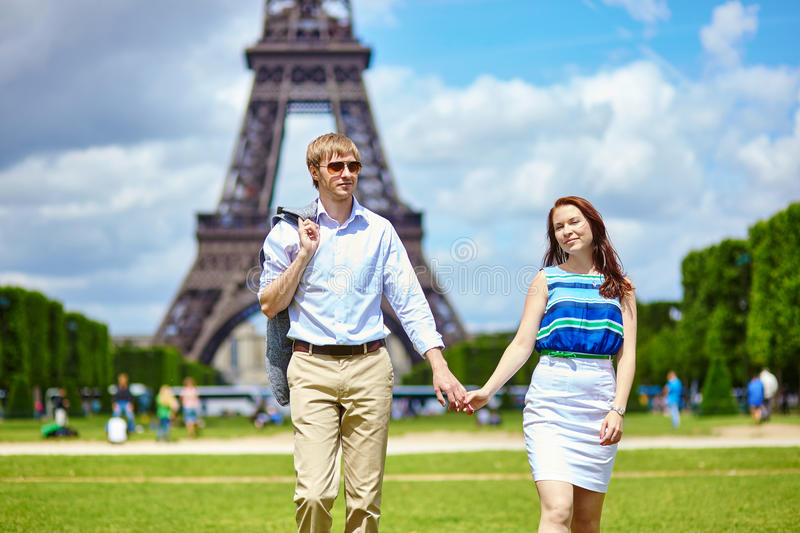Couple walking in Paris near the Eiffel tower royalty free stock photo