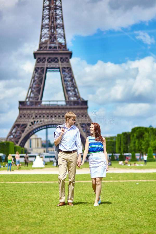 Couple walking in Paris near the Eiffel tower stock image