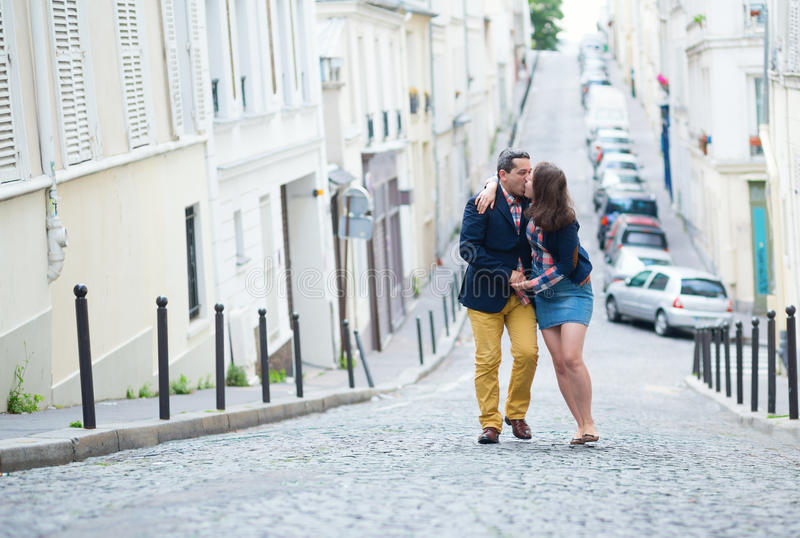 Couple walking in Paris together. Happy couple walking in Paris together royalty free stock photo