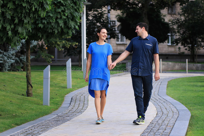 Couple are walking in the park. stock image